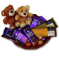 2 Teddies with 5 dairy milk Silk and 2 fruit and nut chocolates in same basket