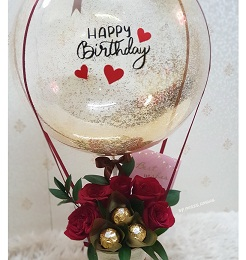 5 Red rose 5 ferrero Rocher chocolates in basket with Printed balloon Happy BirthDay