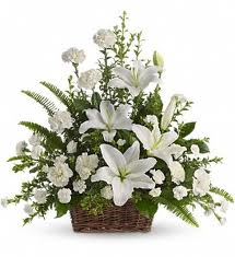 White Lilies in a basket