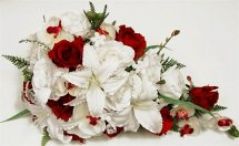 White lilies white orchids Red Roses in Hand Bunch