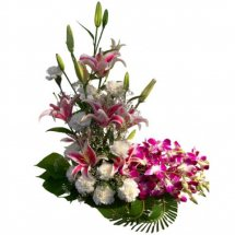 Basket of 4 pink lili 4 purple orchids and 10 white carnations