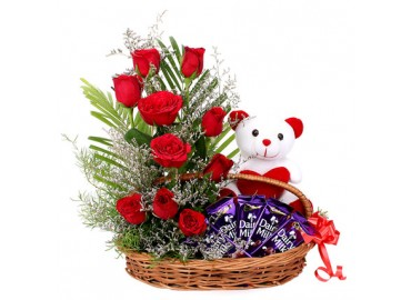 4 Dairy Milk 6 Inch Teddy with 10 red roses in the same basket