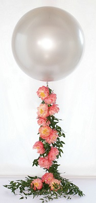 Transparent Balloon with 12 pink roses climbing on the stick of the balloon