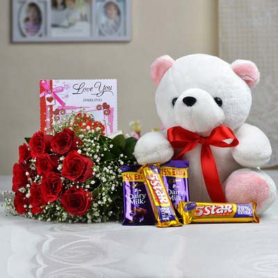 12 red Roses bouquet with a 6 inches Teddy and 5 dairy milk chocolates