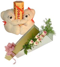 2 Teddies holding tobleronechocolates and 6 pink Roses