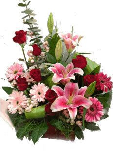 3 pink lilies 6 white gerberas 5 red roses basket