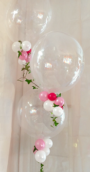 3 Transparent Bubble Balloons with small pink white red balloons trailing on the balloon stick