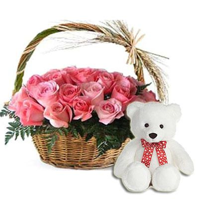 Teddy Bear surrounded by Pink Roses in Basket