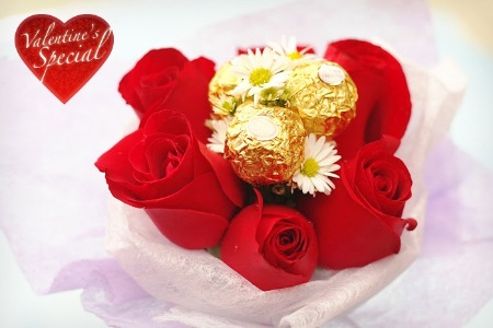 6 red roses with 3 Ferrero rocher in a bouquet