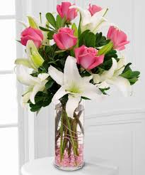 Dozen Pink roses and white Liliums in a Vase