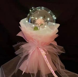 Transparent Balloon with 1 pink rose inside and wrapped in white and pink wrapping and led fairy light string