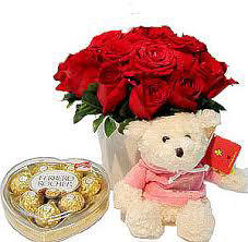 12 Red Roses and heart shaped chocolate box with Teddy 6 inches