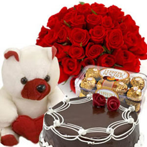 Dozen red Roses and 16 Ferrero Rocher Chocolates 1/2 Kg cake Teddy