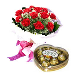 A dozen red roses bouquet with small box of heart chocolates