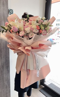 Life Size Pink White and Peach Flowers Bouquet wrapped in paper