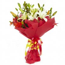 White Liliums bouquet with red wrapping