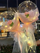 2 pink rose inside 2 transparent Luminous balloon with pink Wrapping