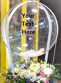 Clear Bubble balloon with your Text on balloon tied to a basket of 12 white flowers