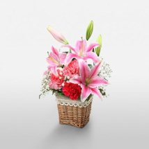 Short stems of 3 Pink lilies 5 red carnations basket