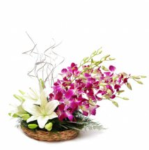 Basket of 3 White lilies and 6 purple orchids