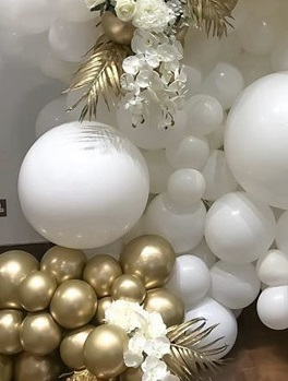 35 White and golden balloons adorned with golden painted palm leaf and white flowers