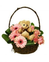 Teddy sitting in Basket of Mix Flowers