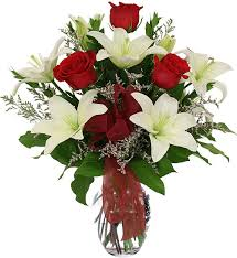 Red roses and white Lilies in vase