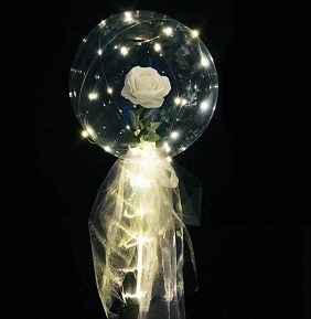 White rose inside a transparent Luminous balloon with white Wrapping